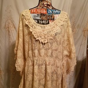 A off white batwing lace blouse...